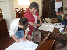 Enid Horton and her daughter Lorinda working on the banns register.