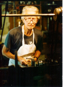 Frank Tearle at his lathe, Hahei.