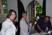 Barbara Tearle, Richard Tearle and Jennie Pugh with the registry book