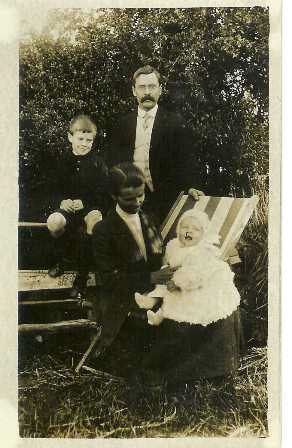 Arthur, Fred, Sadie and Frank in the garden of the company house in Hastings