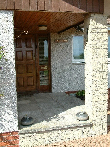 Front door with curling stones