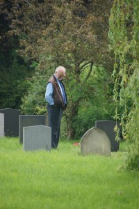 Rod Teale reads some of the Methodist headstones.