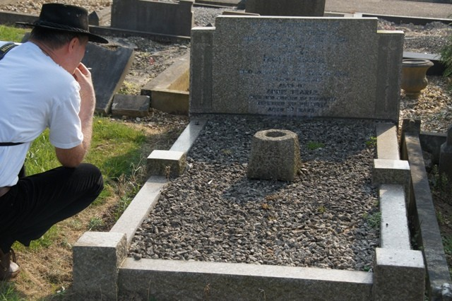 615 H-CON Ewart studies the grave of Alfred, Florence Mary Tearle and Annie nee Hodges. Vicarage Rd Cemetery Watford.